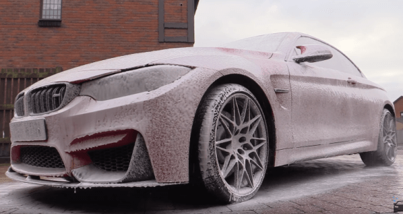 car in foam while wahing with car shampoo